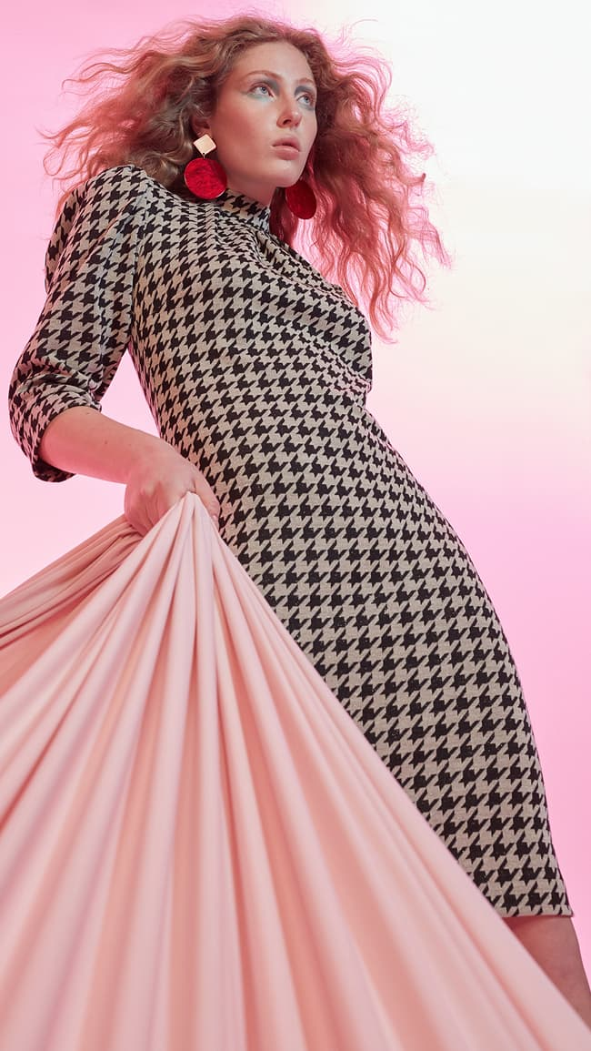 Model wears houndstooth retro dress