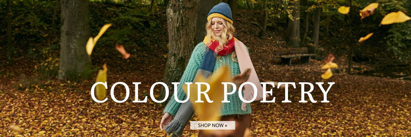 Model wears Sweater in Turquoise and colourful scarf