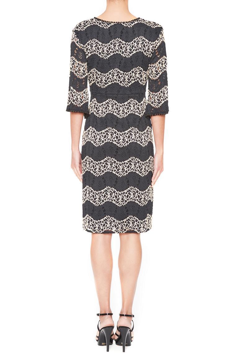 Rear view of Ana Alcazar Crochet Dress Leandra  worn by model