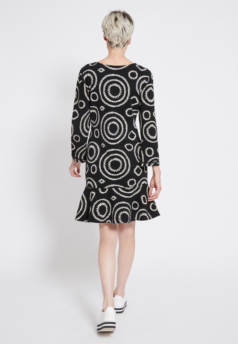 Rear view of Ana Alcazar Volant Dress Presena Black  worn by model
