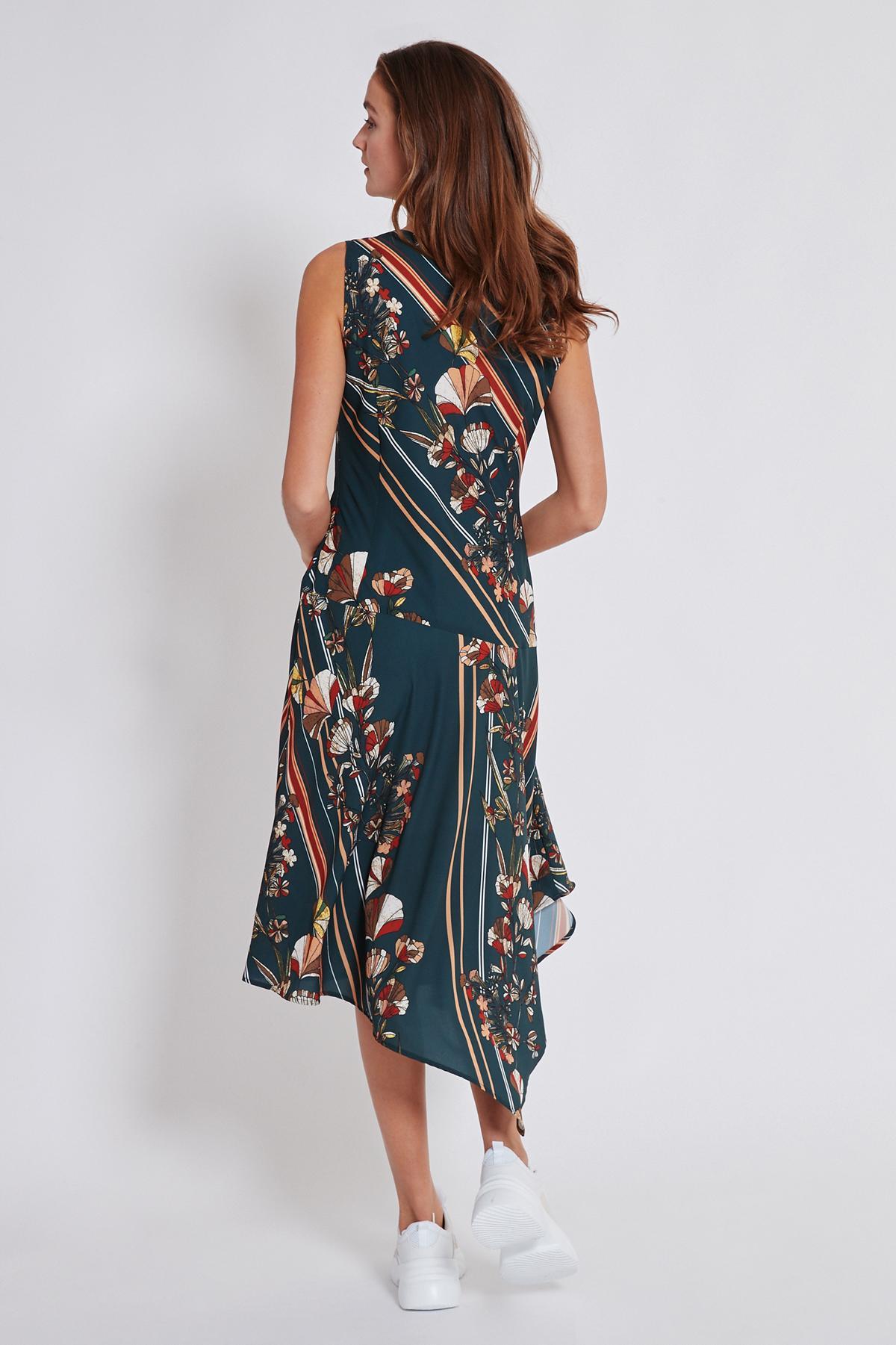 Rear view of Ana Alcazar Midi Dress Talusa  worn by model