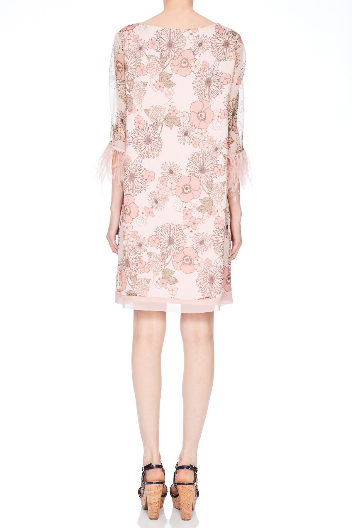 Rear view of Ana Alcazar Feather Silk Dress Naris  worn by model