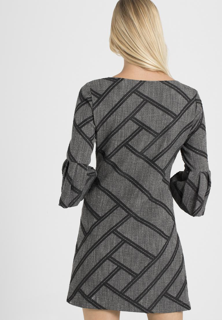 Rear view of Ana Alcazar A-Shaped Dress Osyka  worn by model